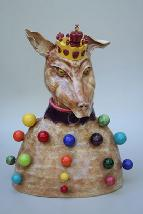 ceramic sculpture of Juggler King dog with multi colored rainbow balls over its body