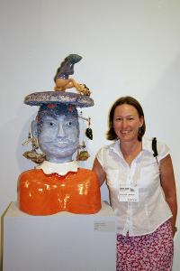 Bay Area Ceranic Sculptor Antonia (Tuppy) Lawson with her Tsunami inspired piece Tin Hau ( Godess of the Sea) part of her Kitchen God Series, shown at the CCACA exhibit at John Natsoulas Gallery