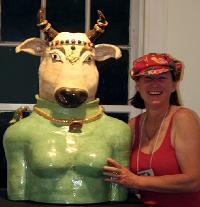 Ceramic sculpture of Holy Cow , Vishnu's Nandi, taken with bay are artist and ceramic sculptor Antonia (Tuppy) Lawson at the John Natsoulas Gallery in Davis California.