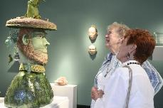 Ceramic sculpture of Earth God at the Thinking Green Show at Art works Down Town
