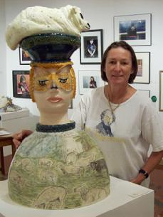 Ceramic sculpture of Bo Peep an English girl with lamb on her head and landscape drawing on body