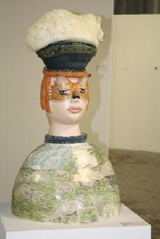 Ceramic sculpture englisg girl with lamb on her head and landscape drawing on body